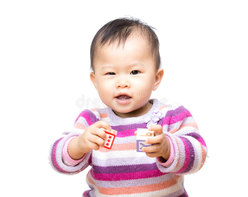 Asia baby girl play toy block and isolated. On white royalty free stock photos