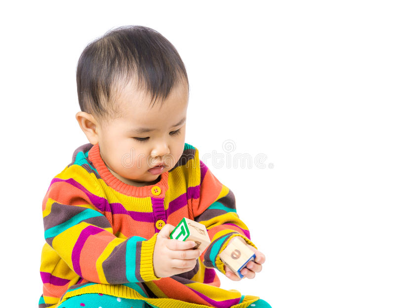 Asia baby girl play with wooden toy block royalty free stock image