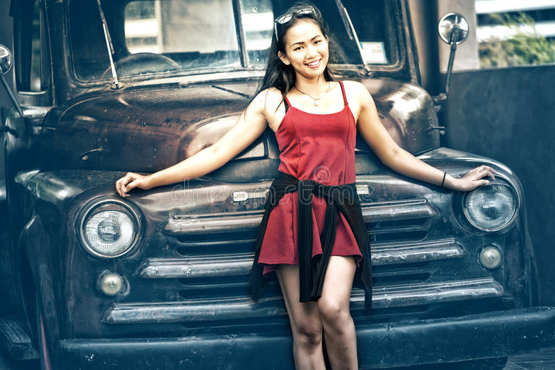 Asia beautiful lady standing near retro car stock image