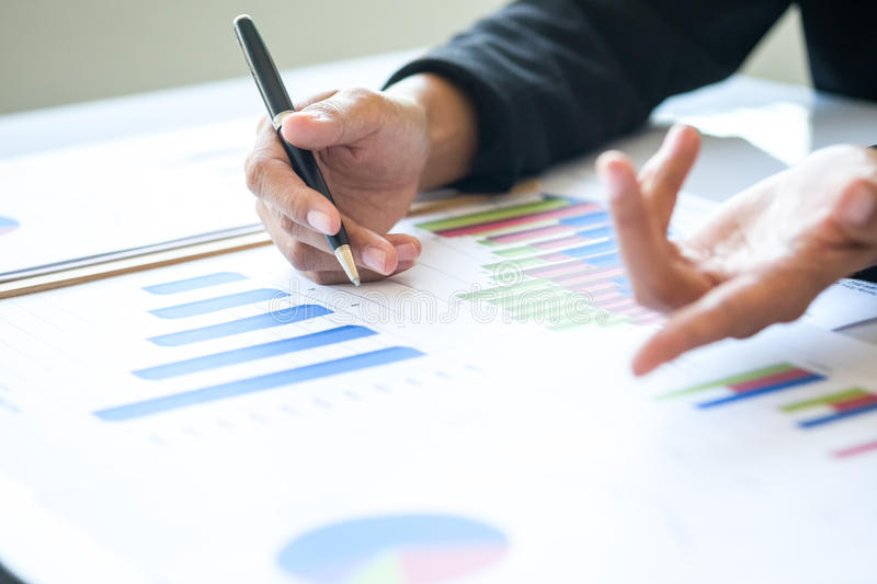Asia business woman analyzing investment charts on desk. royalty free stock photo