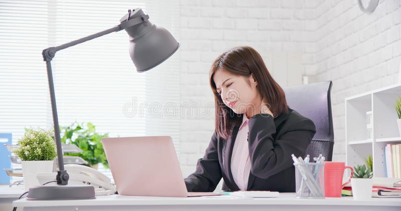 Asia businesswoman overwork. And rely on chair to massage her neck stock photos