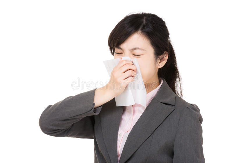 Asia businesswoman sneeze. Isolated on white stock photo