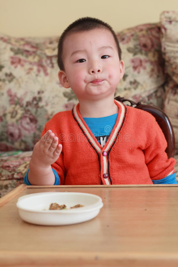 Asia child eat royalty free stock photography