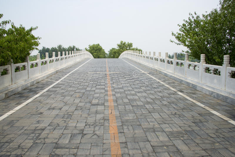 Asia in China, Beijing, Chaoyang Park,Stone bridge, railing. Asia China, Beijing, Chaoyang Park, the main garden green integrated, multi-functional large-scale royalty free stock photography