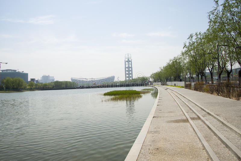 Asia China, Beijing, Olympic Park, architecture and landscape. Asia China, Beijing, Olympic Park, clear water, green willow leaves, distant Linglong tower and royalty free stock images