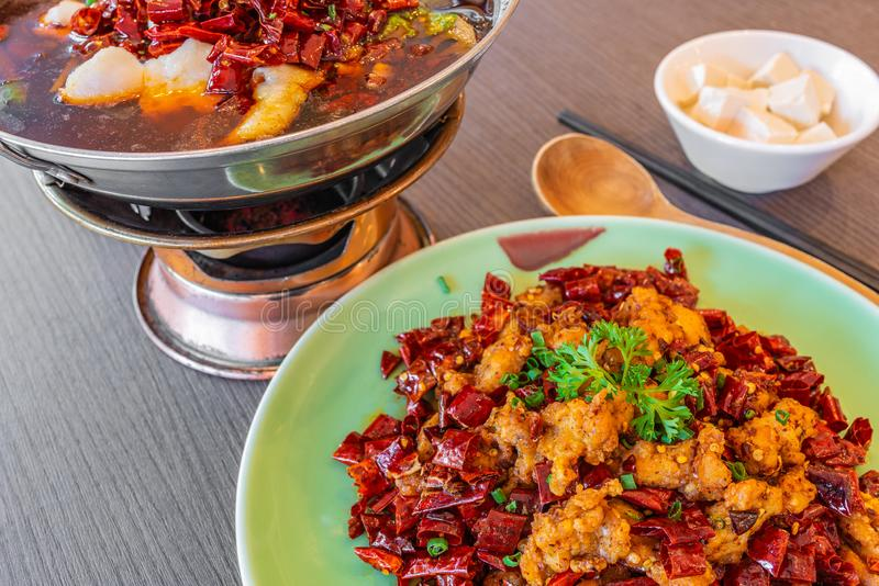 Asia, China food. Szechuan water boiled spicy fresh fish. Fried Chicken side dish. stock images