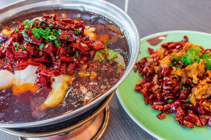 China Chinese Food. Hot pot boiled fish in spicy dried chilli. stock image