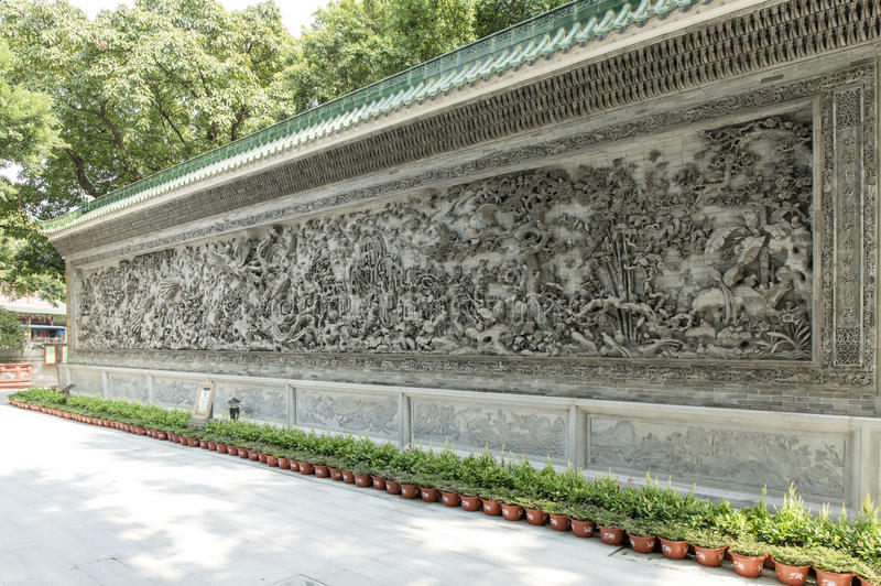 Asian art sculpture Chinese stone wall stock image