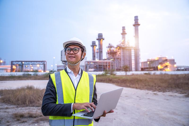 Asia electrical engineer working with computer laptop stock photo