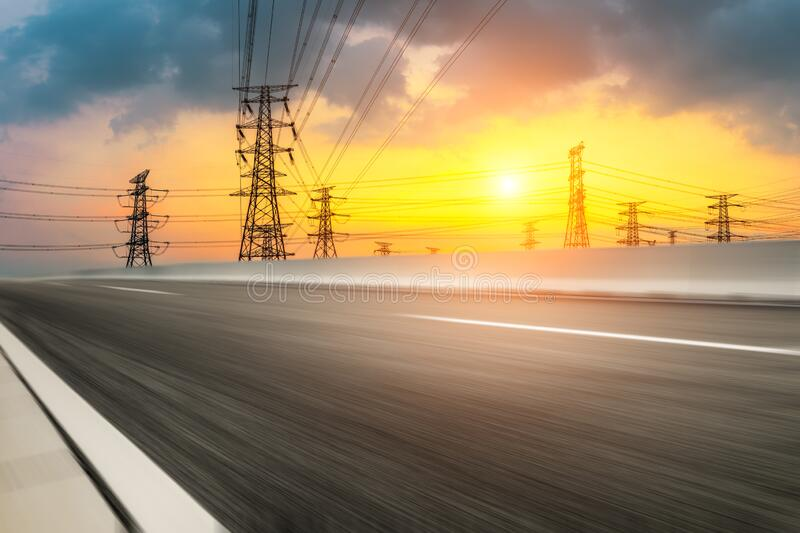 Asia asphalt road and power tower nature landscape at summer sunset. Asia empty asphalt road and power tower nature landscape at summer sunset royalty free stock photos