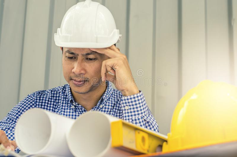 Asia Engineer serious thinking, young man and looking away while sitting at container box background stock images
