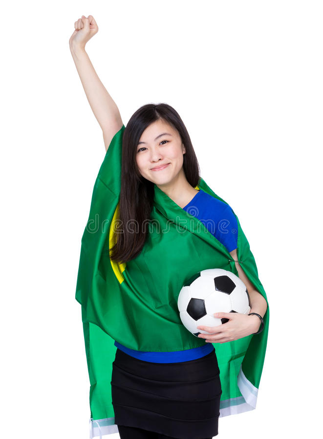 Asia excited woman drape with Brazil flag and football royalty free stock photography
