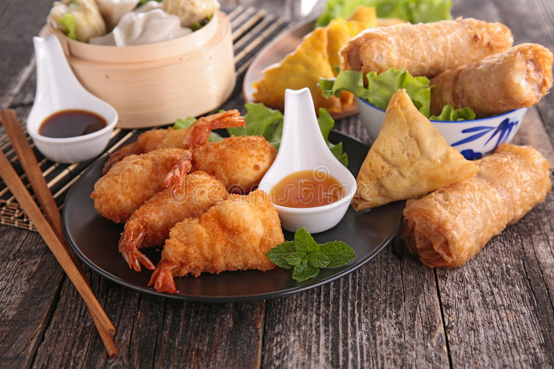 Asia food. Assortment of spring roll,samosa and shrimp royalty free stock image