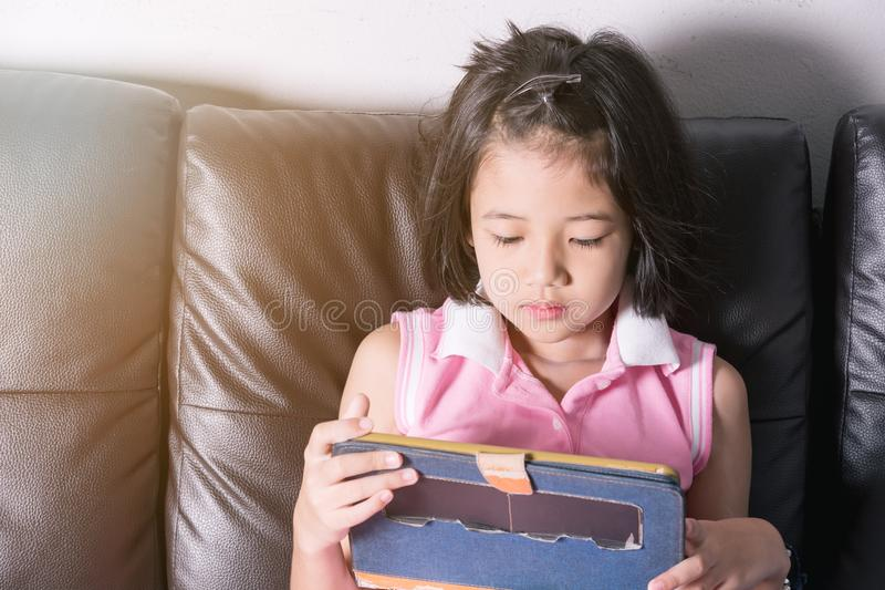 Asia girl happy play tablet stock image