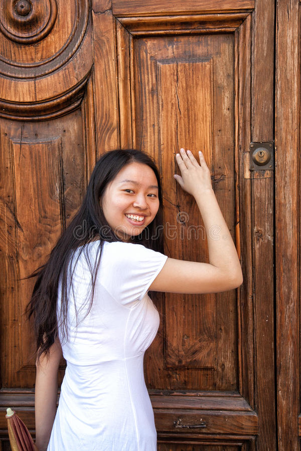 Asia girl knock on door. A chinese girl knock on doorn royalty free stock photos