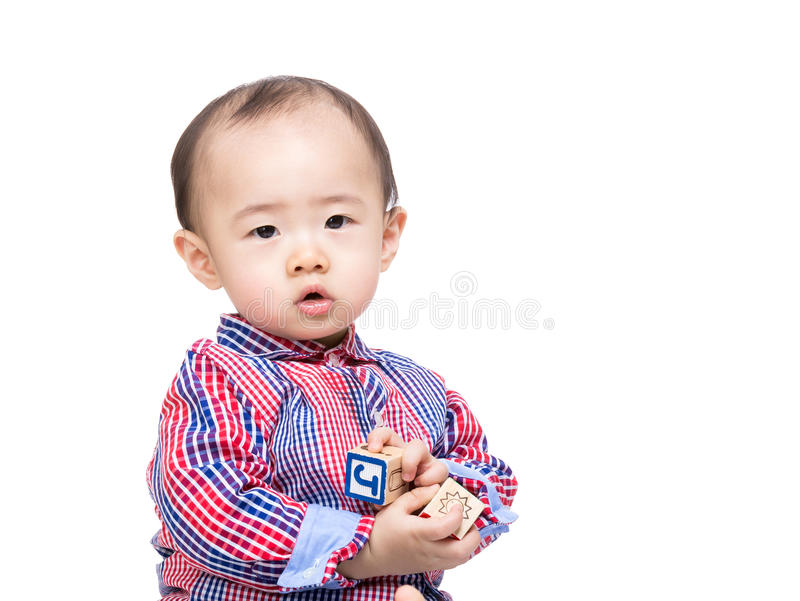 Asia little boy play wooden toy block. Isolated on white stock photography