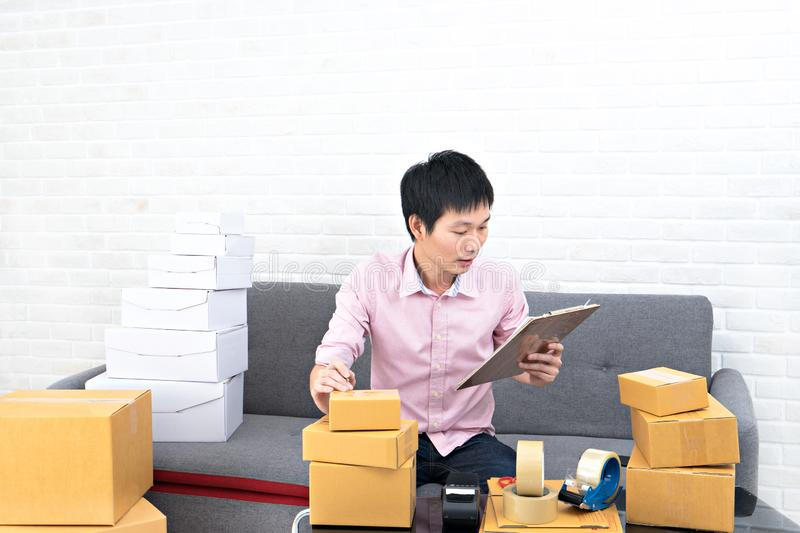 Asia man working business SME online at home. Business start up online concept royalty free stock photo