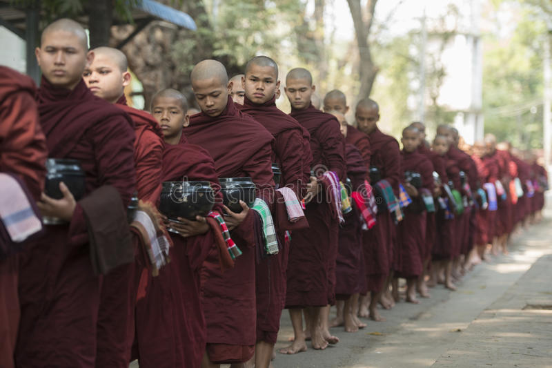 ASIA MYANMAR MANDALAY AMARAPURA MAHA GANAYON KYAUNG MONASTERY. Monks are on the way to the lunch at the Mahagandayon Monastery in Amarapura near the City of stock photo