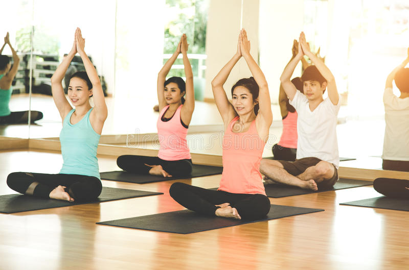 Asia people practicing and exercising vital meditate yoga in class. stock images