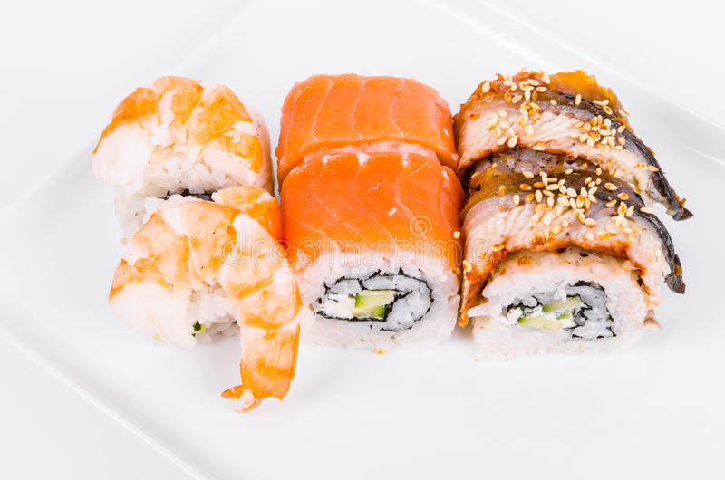 Asia. Tokyo rolls with shrimp, eel and salmon on a white plate o royalty free stock photo