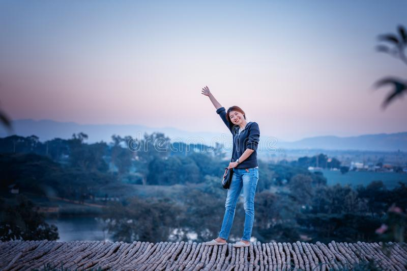 Asia woman posing on view point with mountrain royalty free stock image