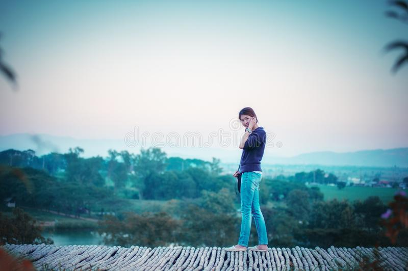 Asia woman posing on view point with mountrain stock photo
