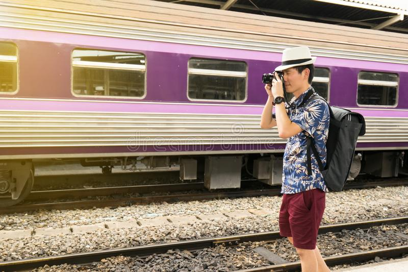 Asia tourist take a photo and travel by the train. Traveler at Thailand royalty free stock images