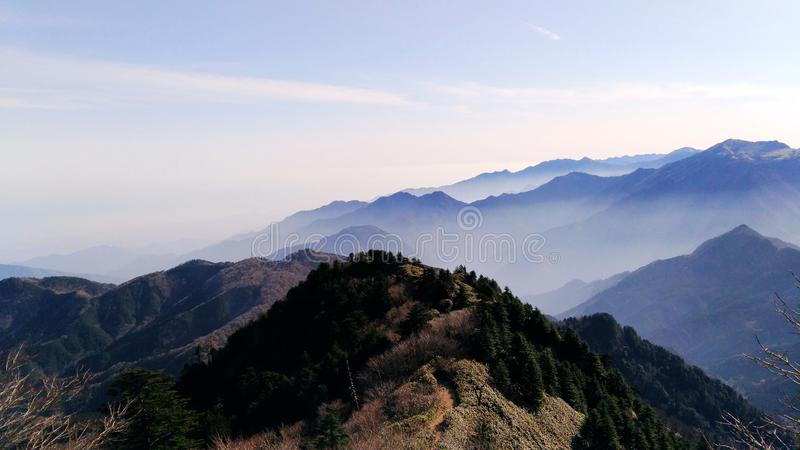 Shaded japanese mountains. Asia travel, Japan, Shikoku island, Ishizuchi San hike, amazing trekking, incredible shade of colors that marks the crest of different royalty free stock photos
