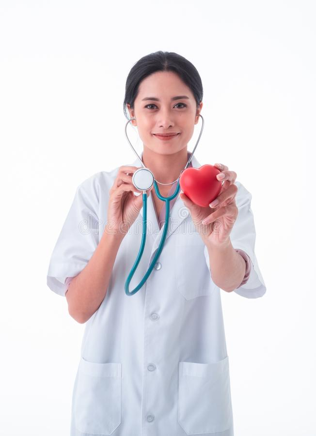 Asia Woman Doctor, with stethoscope holding red heart isolated on white background. stock image