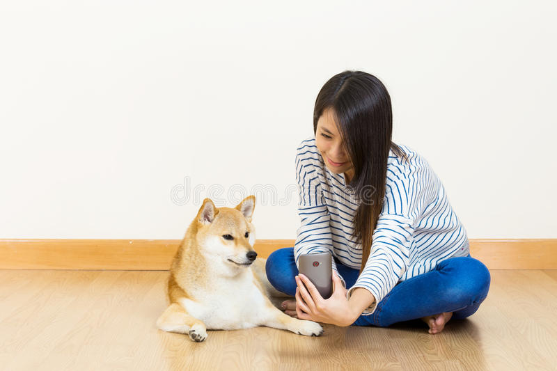 Asia woman and dog selfie. At home royalty free stock image
