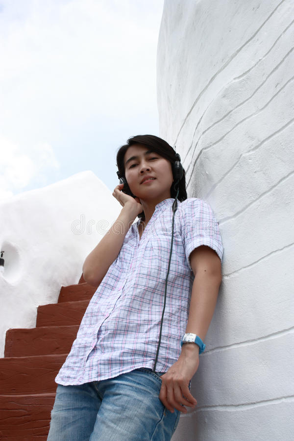 Download Asia Woman Listening To Music On Headphones Stock Image - Image: 16112527
