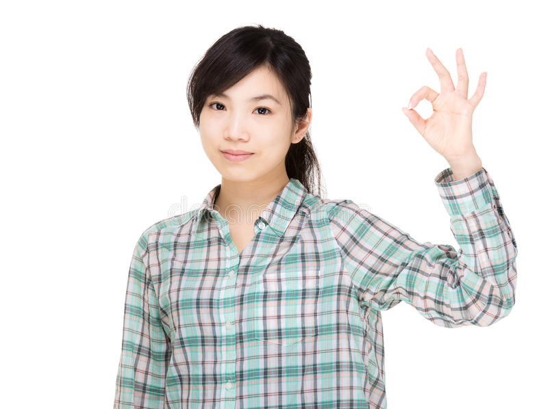Asia woman with ok hand gesture. Isolated on white stock images
