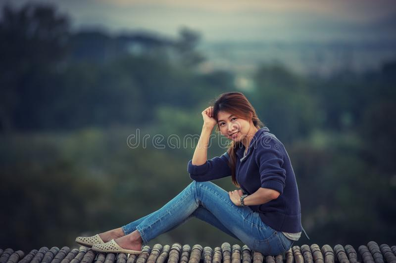 Asia woman posing on view point stock photography