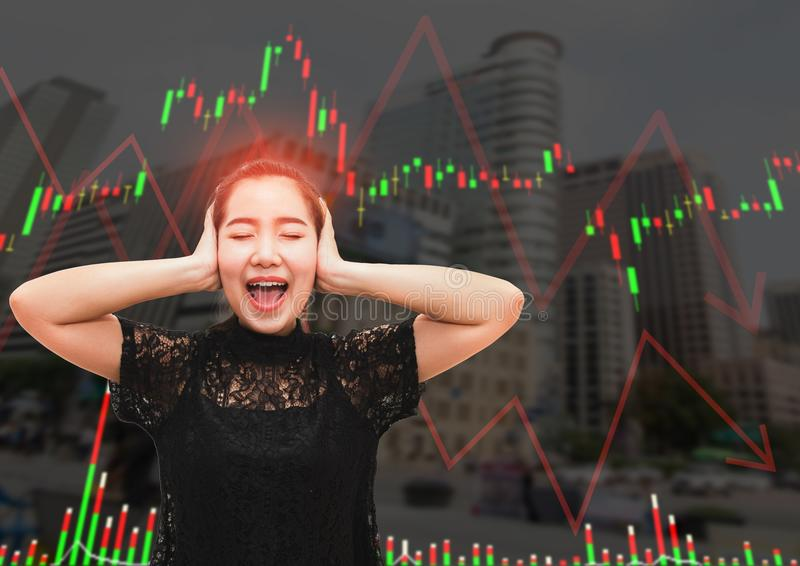 A asia woman stress and headache when stock market fall stock photo