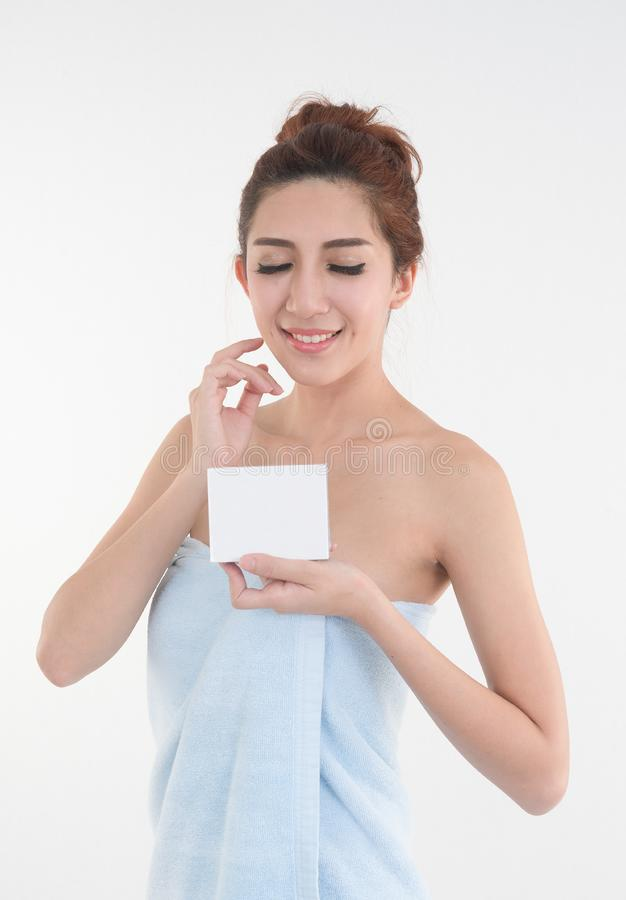 Asia woman in towel showing blank box posing on white background stock image