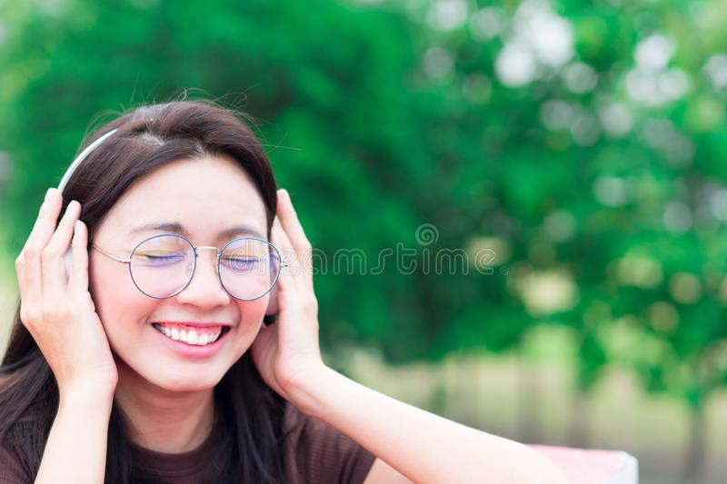 Asia women listening music and smiling with headphones for relax stock images