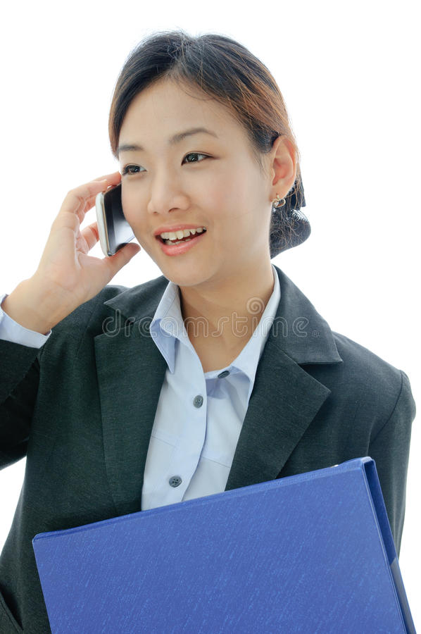 Asia yong businesswoman working on phone royalty free stock photo