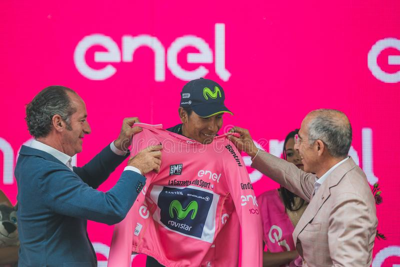 Asiago, Italy May 27, 2017: Nairo Quintana Movistar Team, in pink jersey of the best rider, on the podium. After a hard montain stage of Tour of Italy 2017 that stock photo