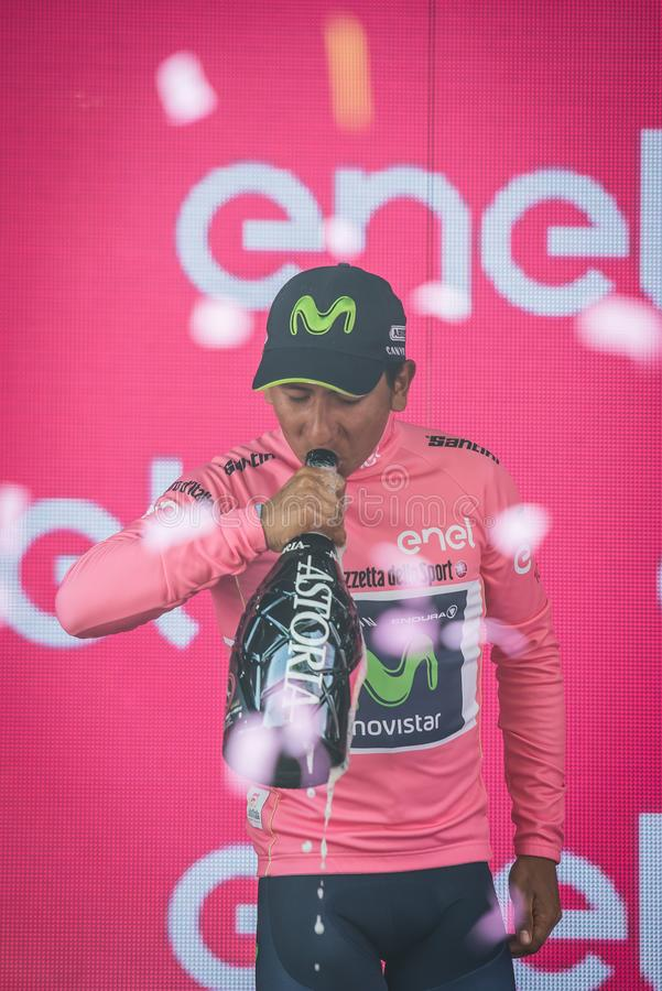 Asiago, Italy May 27, 2017: Nairo Quintana Movistar Team, in pink jersey of the best rider, on the podium. After a hard montain stage of Tour of Italy 2017 that royalty free stock photos