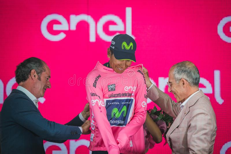 Asiago, Italy May 27, 2017: Nairo Quintana Movistar Team, in pink jersey of the best rider, on the podium. After a hard montain stage of Tour of Italy 2017 that royalty free stock image