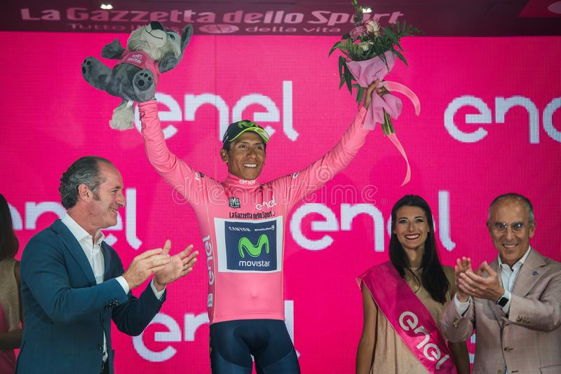 Asiago, Italy May 27, 2017: Nairo Quintana Movistar Team, in pink jersey of the best rider, on the podium. After a hard montain stage of Tour of Italy 2017 that royalty free stock photo