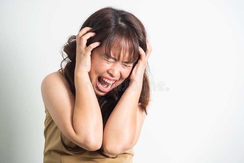 Asian adult woman screaming. Portrait on white background with d royalty free stock photos