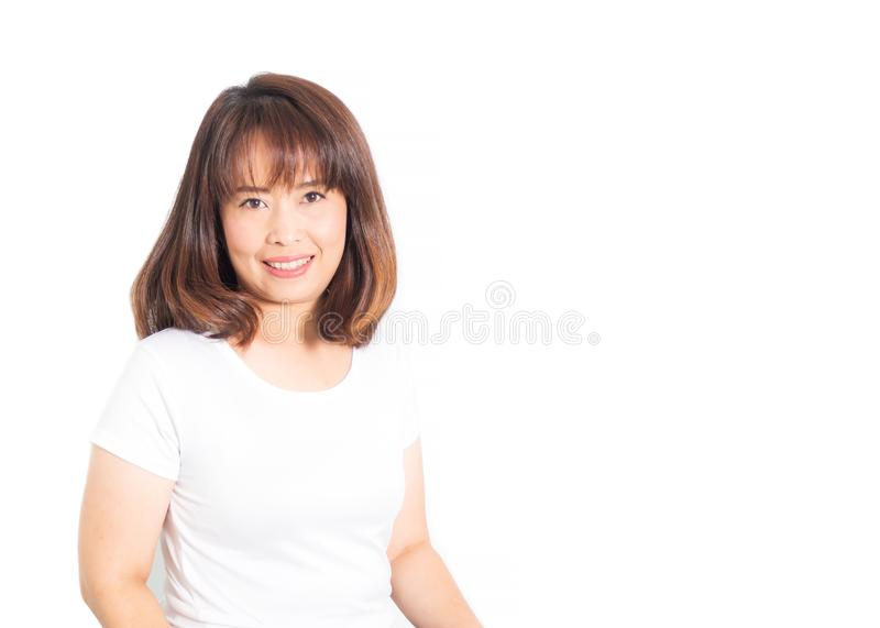 Asian adult woman smiling and looking camera. Portrait on white royalty free stock photos