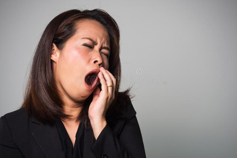 Asian adult woman yawn. Tired and sleepy emotion. Business women stock image