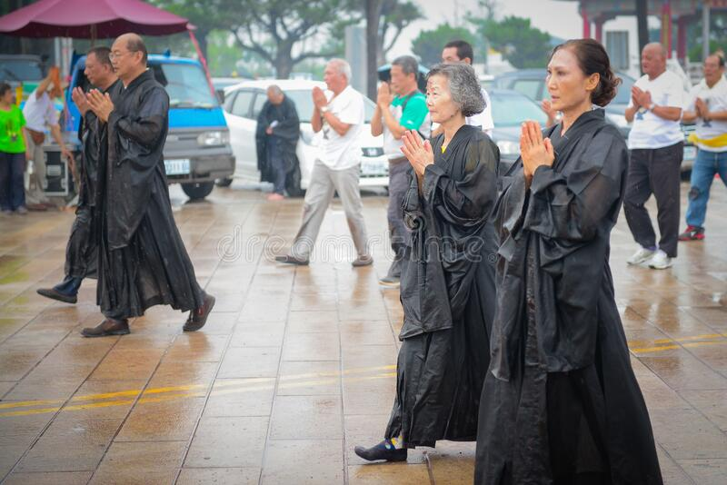 Asian adults in somber parade royalty free stock photo