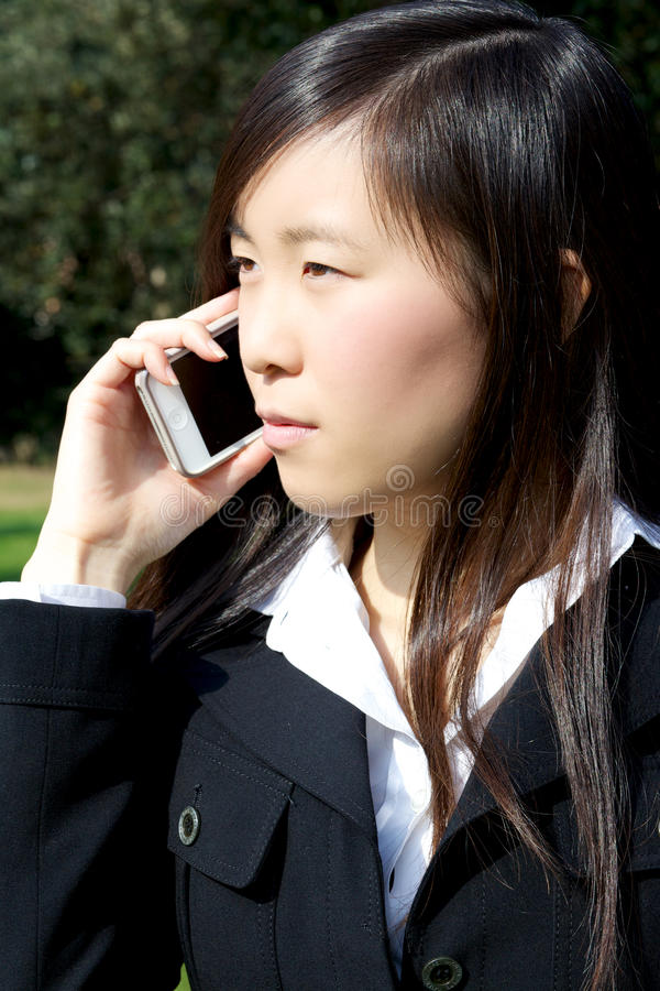 Asian american business woman on the phone stock image