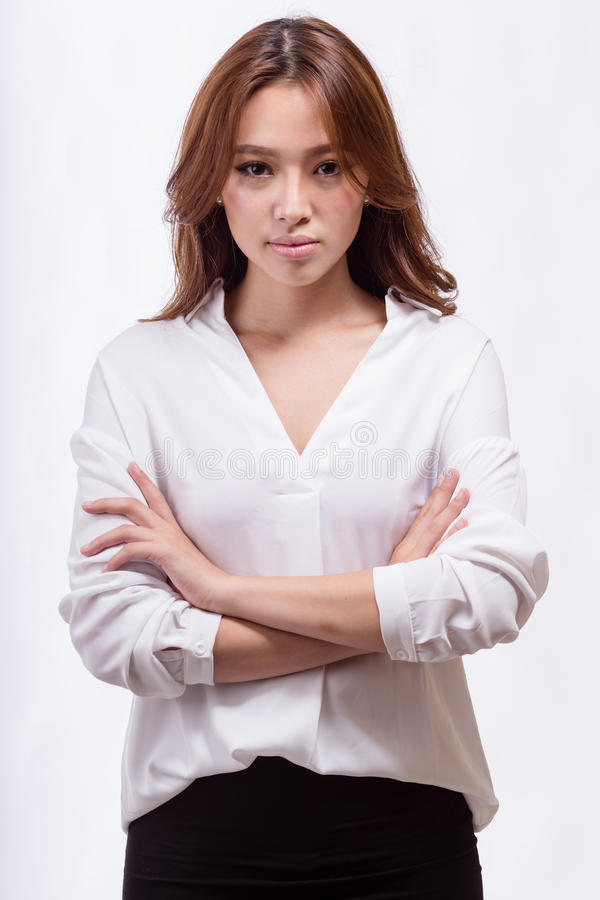 Asian American businesswoman with crossed arms royalty free stock photo