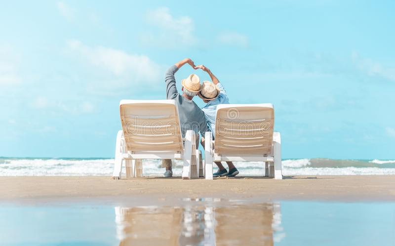 Asian amusing elderly couple went to the beach to enjoy the sea breeze stock photography