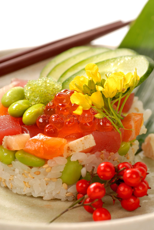 Asian appetizer of rice and tuna with vegetables royalty free stock photos