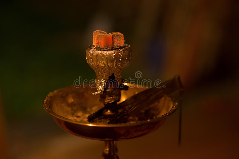 Asian, arabia hookah with charcoal. Dark stock image